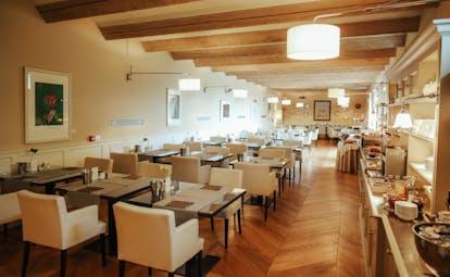 Villa D'Amelia Piemonte cream walls and wooden floors of breakfast room