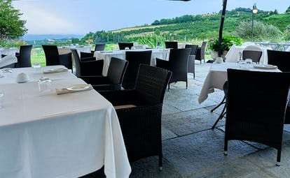 Villa D'Amelia Piemonte terrace with views and outdoor dining with white table cloths