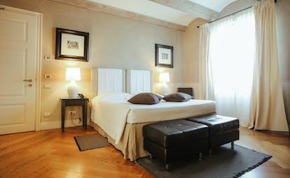 Villa D'Amelia Piemonte cream coloured room with wooden floor