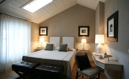 Villa D'Amelia Piemonte cream and brown coloured room with sloping ceiling
