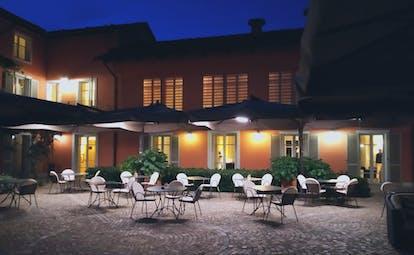 Villa D'Amelia Piemonte courtyard with lights at night