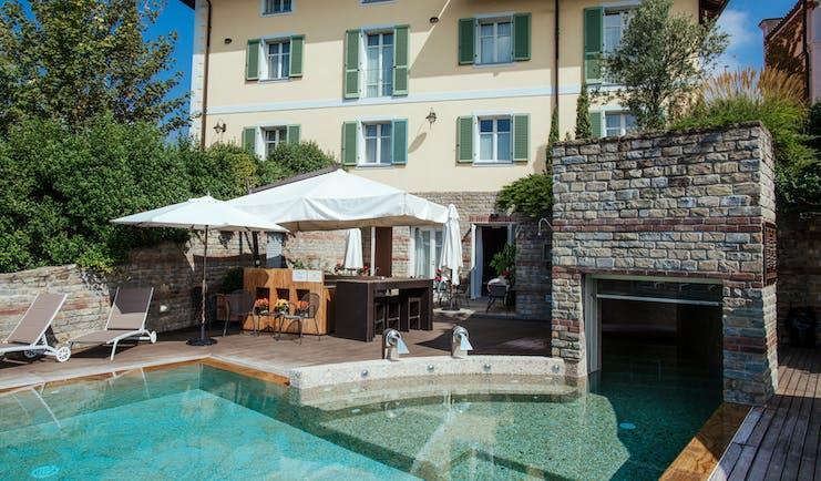 Villa D'Amelia Piemonte swimming pool looking towards villa hotel with green shutters