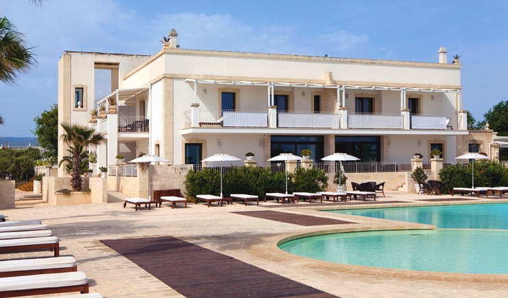 Canne Bianche Puglia exterior rear pool sun loungers umbrellas pool terrace