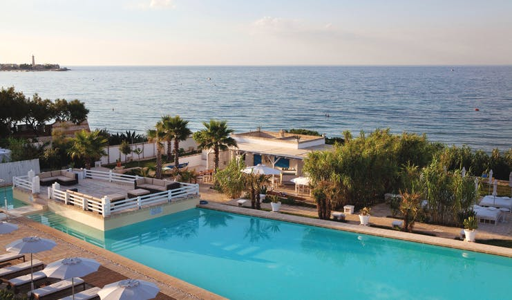Canne Bianche Puglia pool side pool terrace sea in the background