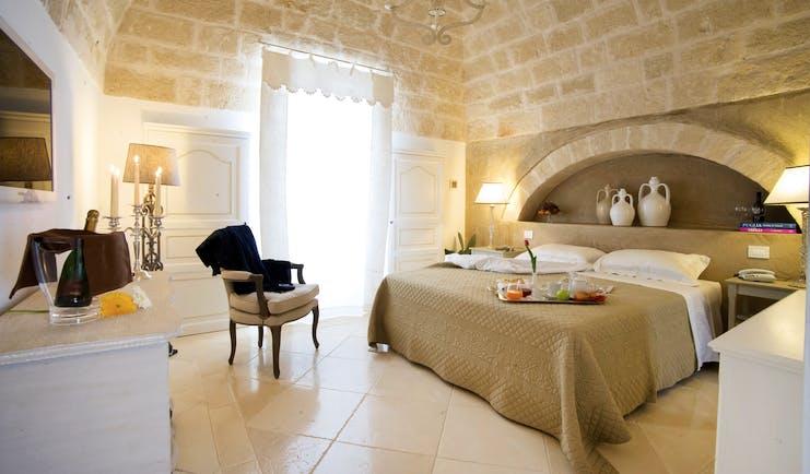 Don Ferrante Puglia deluxe room bed stone walls contemporary décor