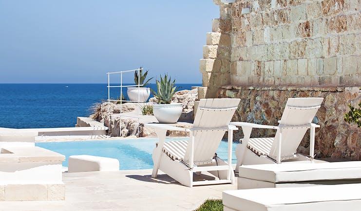 Don Ferrante Puglia jacuzzi pool sun loungers overlooking the sea