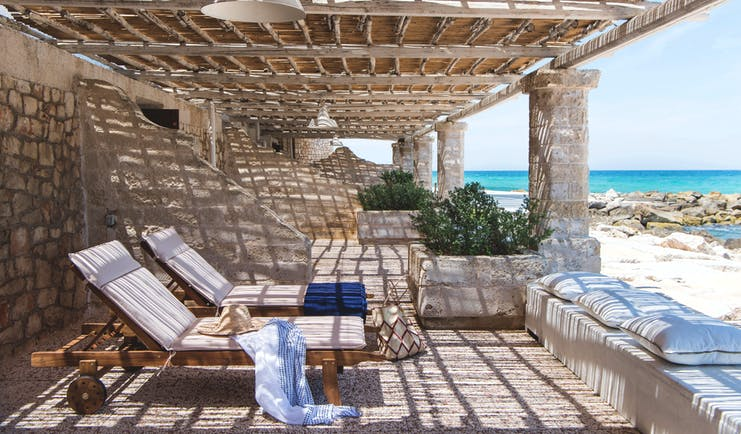 La Peschiera Puglia patio on the beach shaded area with sun loungers