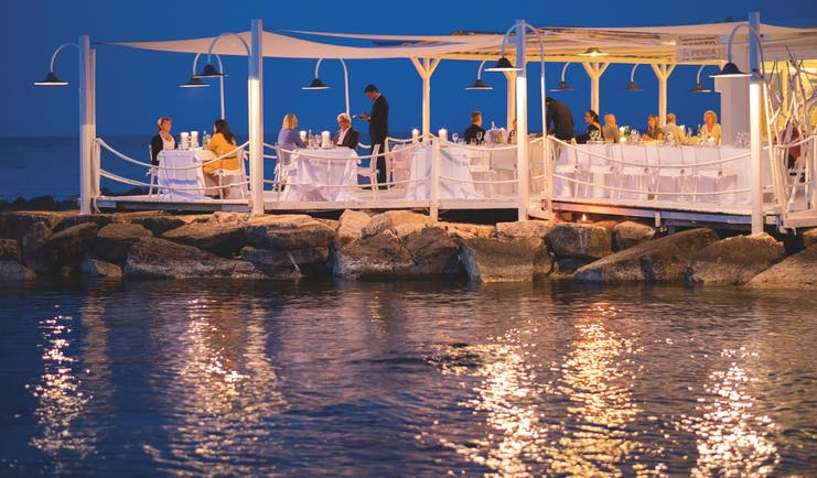 La Peschiera Puglia beach restaurant by night terrace water front dining