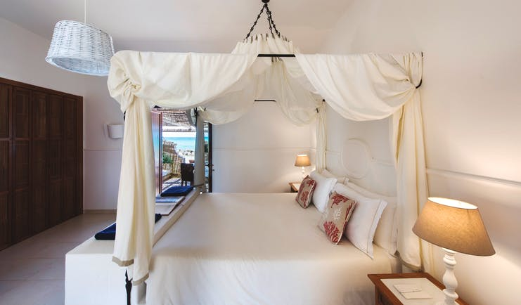 La Peschiera Puglia sunrise room canopied bed doors out to private terrace