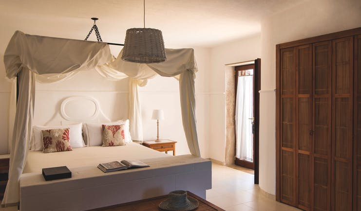La Peschiera Puglia sunshine room canopied  bed doors leading to terrace facing the sea