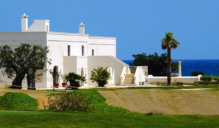 Masseria San Domenico Puglia exterior hotel building lawns sea in background