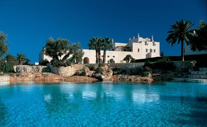 Masseria San Domenico Puglia pool blue water hotel building