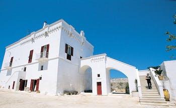 Masseria Torre Coccaro Puglia exterior hotel building white stone traditional architecture