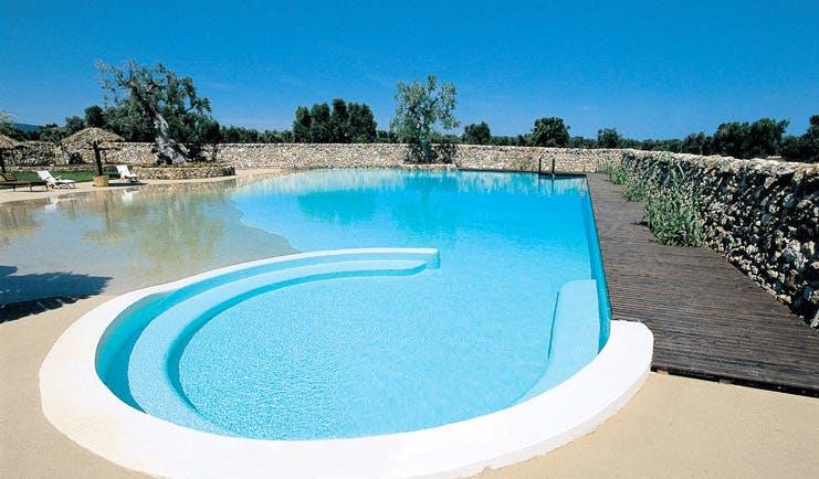 Masseria Torre Coccaro Puglia pool jacuzzi terrace sun loungers terrace