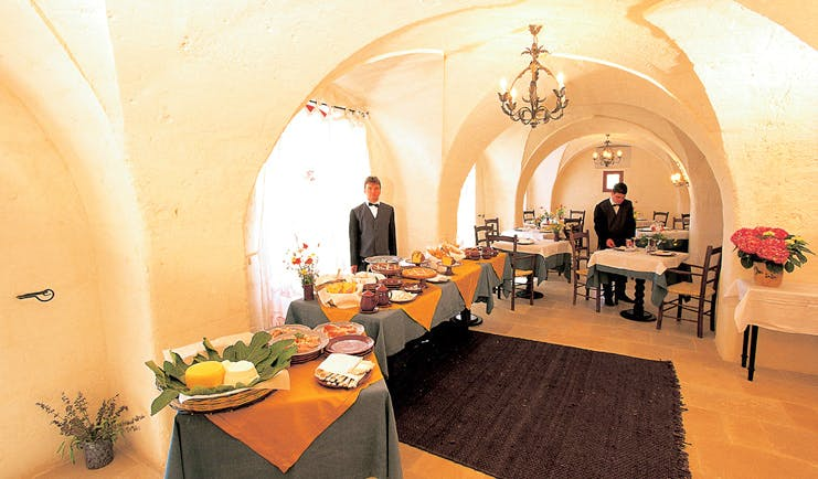 Masseria Torre Coccaro Puglia restaurant buffet waiter traditional décor