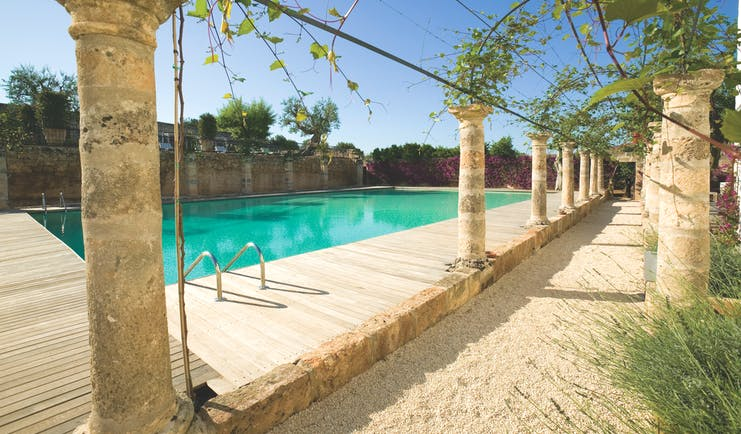 Masseria Torre Maizza Puglia pool terrace stone colonnades