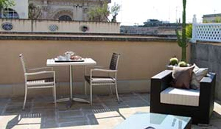 Patria Palace Puglia private terrace outdoor seating and dining area