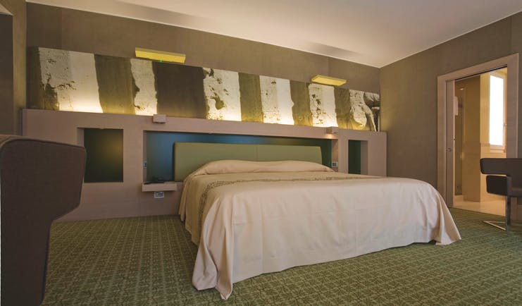 Risorgimento Resort Puglia executive bedroom bed en suite bathroom modern décor