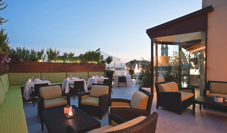 Risorgimento Resort Puglia outdoor dining rooftop restaurant at dusk