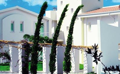 Hotel La Coluccia Sardinia gardens trees lawn hotel building modern architecture