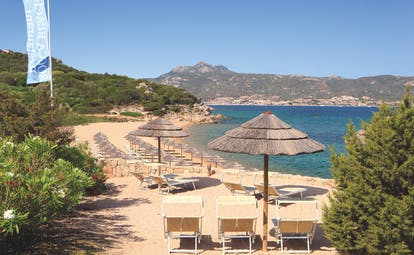 La Rocca Sardinia beach sun loungers umbrellas sandy beach