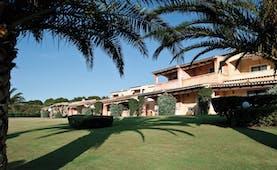 La Rocca Sardinia hotel exterior building lawns trees