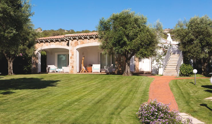 La Rocca Sardinia exterior view suites lawns trees patios