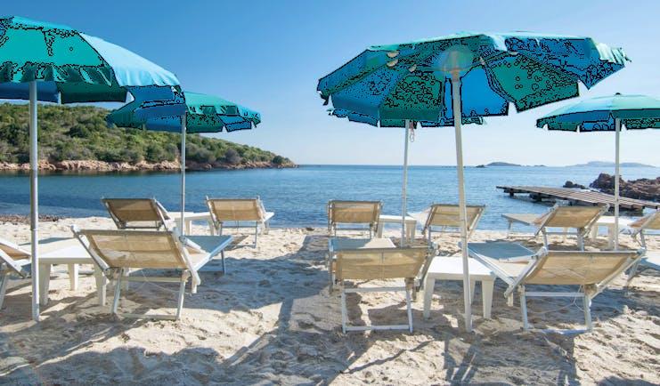Hotel Le Ginestre Sardinia beach, white sand, sun loungers, umbrellas