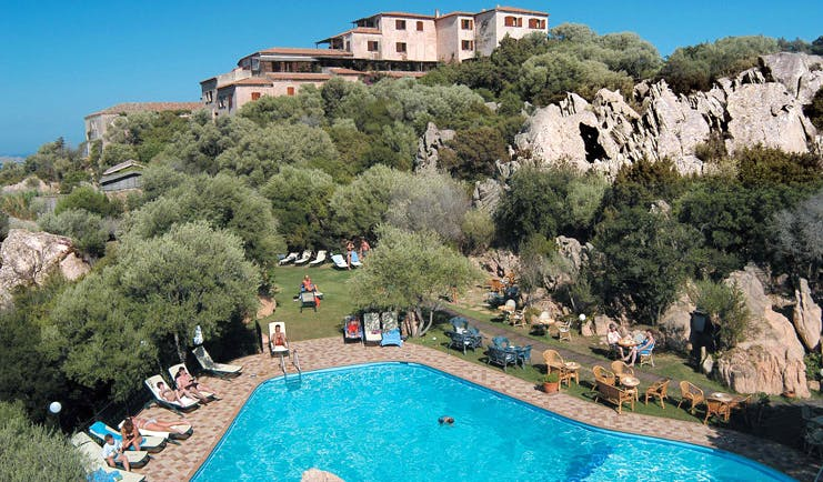 Hotel Rocce Sarde Sardinia pool sun loungers gardens hotel building in background