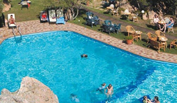 Hotel Rocce Sarde Sardinia poolside sun loungers lawns