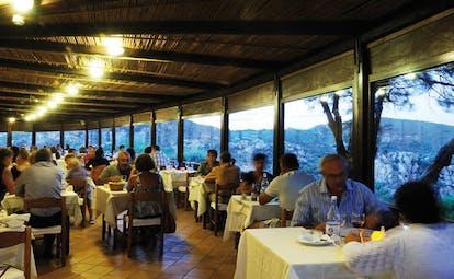 Hotel Rocce Sarde Sardinia restaurant indoor dining area modern décor