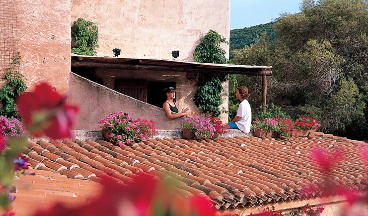 Hotel Rocce Sarde Sardinia terrace ladies chatting traditional rood tiles
