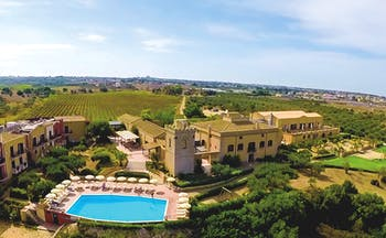Baglio Oneto aerial shot of hotel showing hotel buildings, pool and surrounding Sicilian countrysode