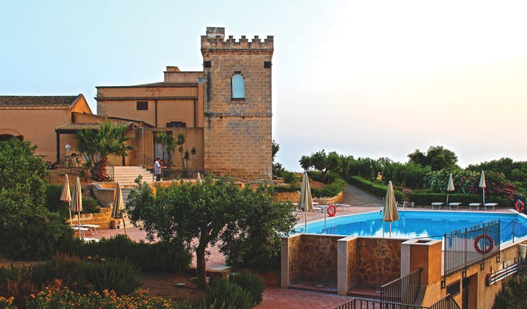 Baglio Oneto exterior, hotel buildings and pool, traditional Sicilian architecture
