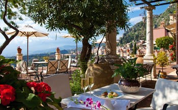 Grand Hotel Timeo Sicily dining terrace outdoor dining overlooking sea