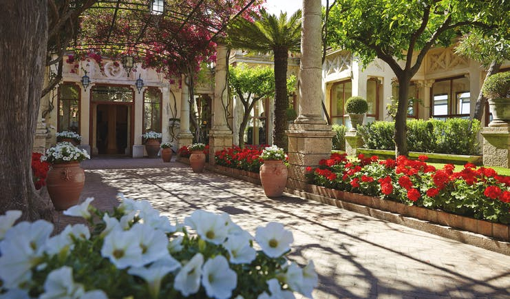 Grand Hotel Timeo Sicily exterior colonnaded pathway lawns flowers