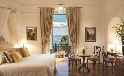Grand Hotel Timeo Sicily junior suite bedroom balcony with sea views stylish décor