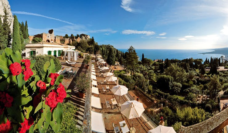 Grand Hotel Timeo Sicily terrace seating umbrellas countryside and sea views