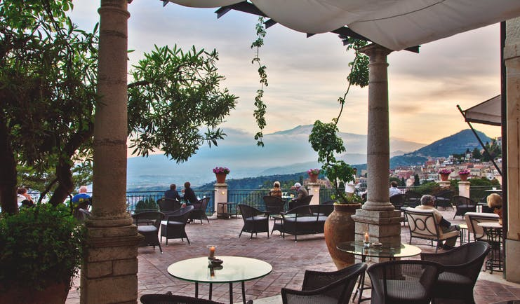 Grand Hotel Timeo Sicily terrace outdoor dining area overlooking island