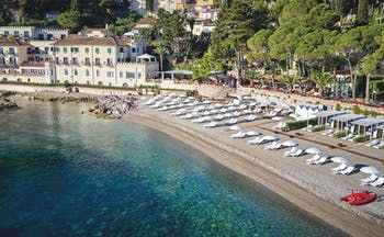 Villa Sant Andrea Sicily aerial shot of beach and  sun loungers umbrellas