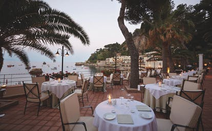 Villa Sant Andrea Sicily outdoor dining on the terrace overlooking the sea
