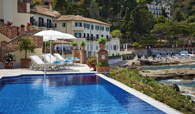 Villa Sant Andrea Sicily exterior pool hotel building pool sun lounger
