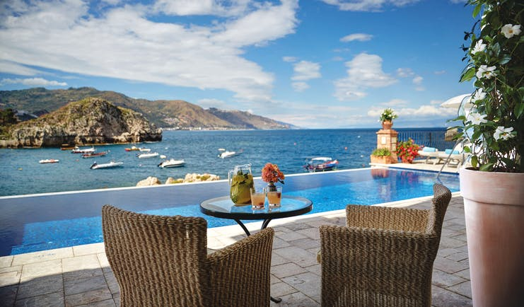 Villa Sant Andrea Sicily infinity pool and outdoor seating area overlooking sea