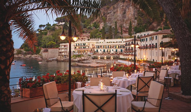 Villa Sant Andrea Sicily terrace outdoor dining terrace overlooking the sea candle light