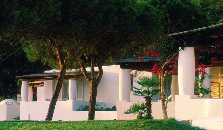 Capofaro Hotel Sicily hotel building white wash walls flat roofs lawn trees