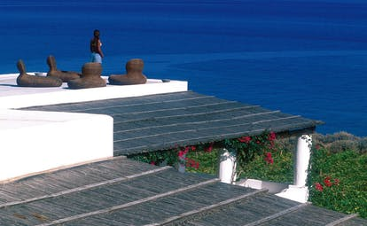 Capofaro Hotel Sicily roof terrace outdoor seating area overlooking the sea
