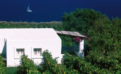 Capofaro Hotel Sicily suite 21 exterior flat roofed building vineyard surrounds sea views