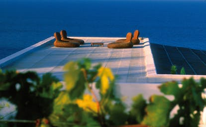 Capofaro Hotel Sicily terrace on flat rooftop overlooking sea