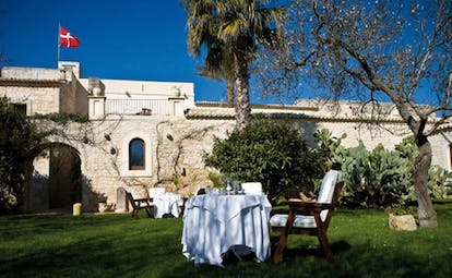 Eremo Della Giubiliana Sicily gardens tables and chairs lawn trees shrubs