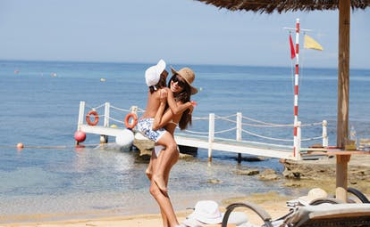 Giardino Di Constanza Sicily beach mother and child playing on the sand